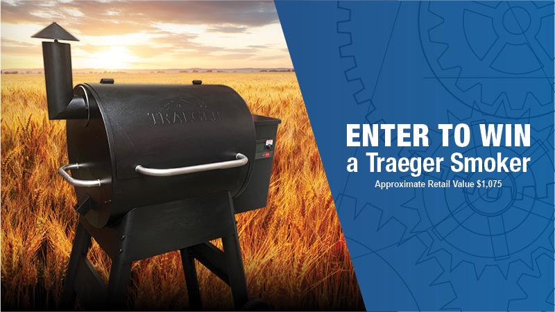 Traeger Smoker set against a harvest field
