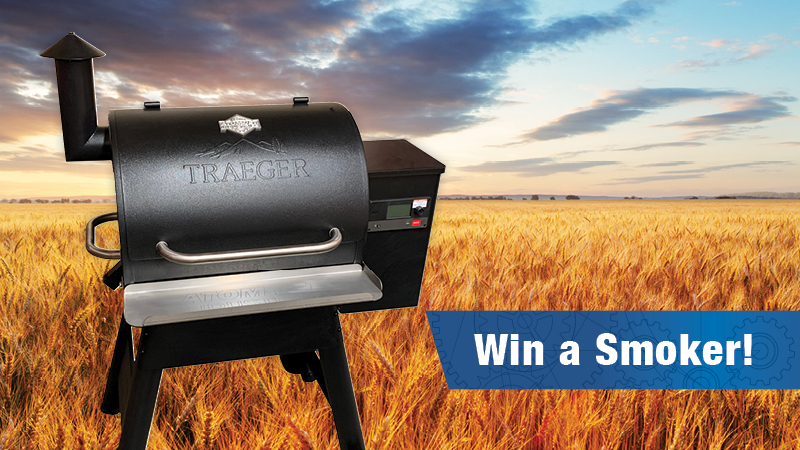 Traeger smoker set against a harvest-ready field.